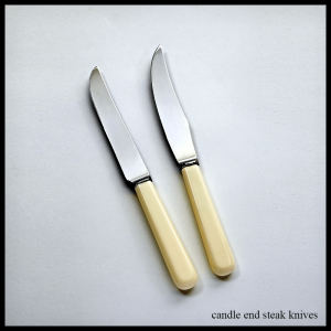 cream handled cutlery candle end steak knives
